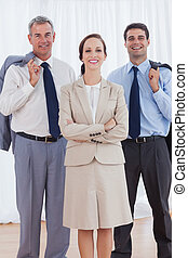 Cheerful businesswoman posing with her work team