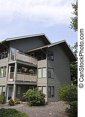 Grey Siding Condos - Old traditional condominium building of...