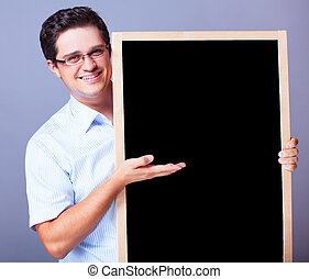Handsome man with blackboard.