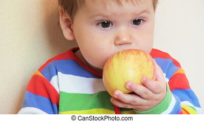 Adorable child with apples