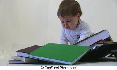 Little baby among books