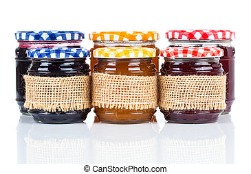 homemade jars with jam, on white background.