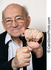 Senior adult with a crutch - Portrait of an old senior adult...