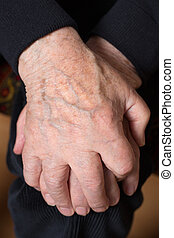 Hands of an old senior adult