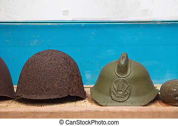 Vintage WWII Army Helmet in military soviet bunker - old...
