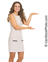 Happy young woman presenting something