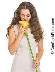 Young woman enjoying kala flower