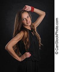 Beautiful stylish sexy woman on black background, studio shot