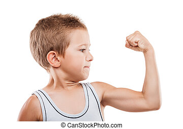 Smiling sport child boy showing hand biceps muscles strength...