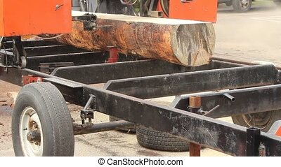 bandsaw sawmill - large portable band-saw cutting logs into...