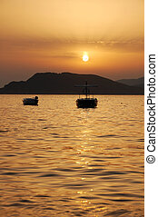 Sunset in Montenegro - Boats in sunset. Montenegro