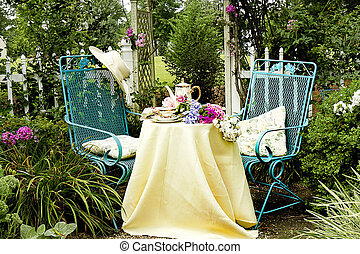 Sunhat on Chair Garden Tea - Afternoon tea setting in a...