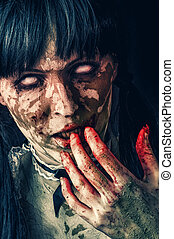 Scary zombie woman with white eyes and bloody hand