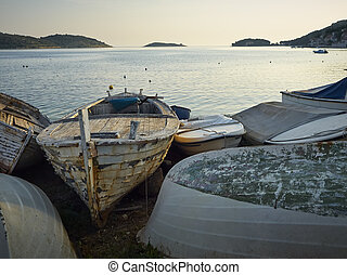 Abandoned boats - ?bandoned boats on coast of the island of...