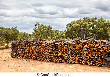 Pile of raw cork newly stripped from tree drying in the sun