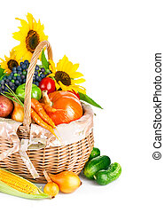 autumnal harvest vegetables and fruits in basket - autumnal...