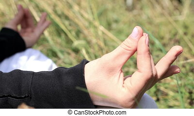 Yoga exercises. Close up of hands.