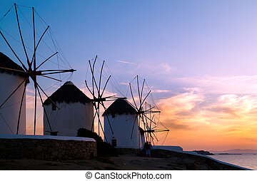 Sunset with famous windmills on Mykonos island, Greece