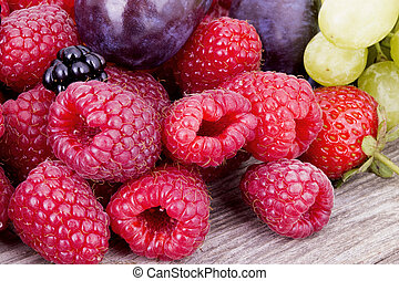 tasty summer fruits on a wooden table