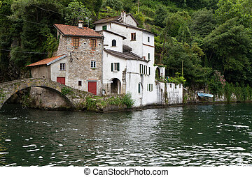 Old villas and houses in Nesso village at lake Como, Italy
