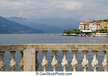 Natural stone balustrade at lake Como with view to Belaggio...