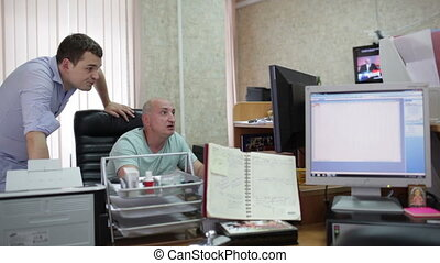 Two men are working in the office