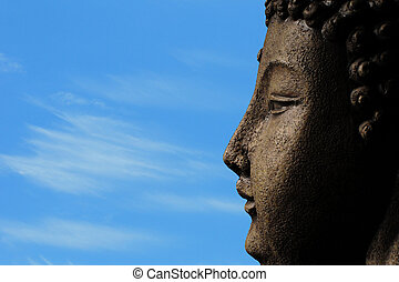 a buddha against a blue sky for enlightenment