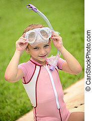 pretty girl with goggles and snorkel in summer