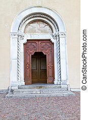 "Church door of ""Santa Tecla"" church in the village of Torno,..."