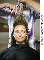 woman in hairdresser shop cutting long hair - female client...