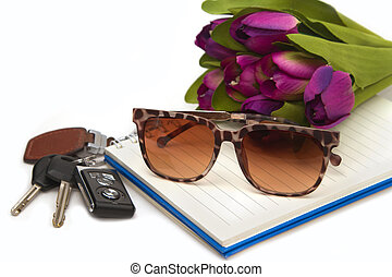 sunglasses and car key on book, concept travelling out door
