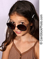 Pretty young girl with sun glasses - Portrait of a pretty...