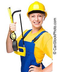 Young construction worker with hacksaw - Young happy lady as...