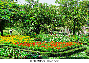 Pretty manicured flower garden with colorful