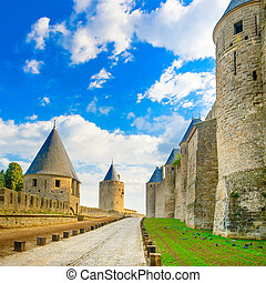 Carcassonne Cite, medieval fortified city on sunset. Unesco...
