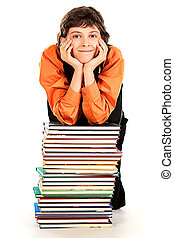 dreaminess - Happy schoolboy sitting with a stack of books....