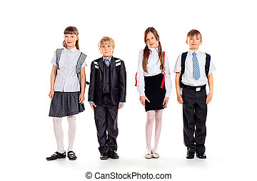 school uniform - Group of happy schoolchildren standing...