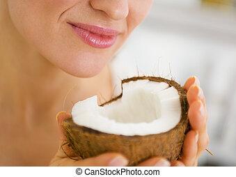 Closeup on young woman enjoying coconut