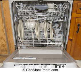 Dishwasher - An open dishwasher showing the clean dishes...