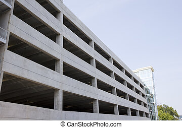 New Parking Deck - A new concrete parking garage under blue...