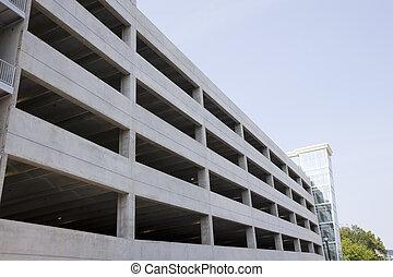 New Parking Deck - A new concrete parking garage under blue...