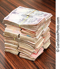 Indian rupees stack - Stack of Indian rupees on a table