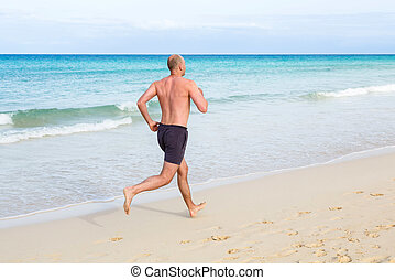 Middle aged man running - Middle aged man jogging in summer...