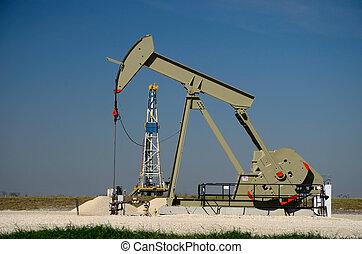 Pump Jack and Derrick - Pump jack with a derrick drilling a...
