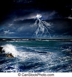 Thunderstorm in sea - Image of night stormy sea with big...