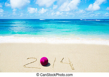 Number 2014 on the sand - holiday concept