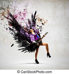 Rock passionate girl with black wings - Young attractive...