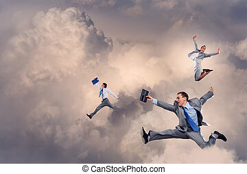 Successful businesspeople - Image of businesspeople jumping...