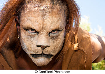 Lion Man meancing close up - Close -up and meancing face of...