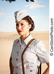 WWII Nurse portrait - A beautiful young WWII nurse, in...